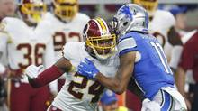 In this photo taken Oct. 23, 2016, Washington Redskins cornerback Josh Norman (24) and Detroit Lions wide receiver Marvin Jones (11) push each other during the first half of an NFL football game in Detroit. Leave it to Norman to speak his mind. Asked how he thinks the NFL product could be improved, the never-shy, oft-fined Washington Redskins cornerback quickly offered one suggestion: It's time for some turnover at league headquarters. (AP Photo/Paul Sancya)