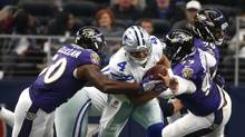 Dallas Cowboys quarterback Dak Prescott is pressured by Baltimore Ravens outside linebacker Albert McClellan, left, and defensive end Timmy Jernigan on Nov. 20, 2016. (Jose Yau/The Associated Press)