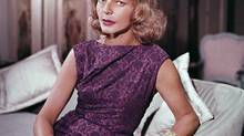 Lauren Bacall, shown at her New York home in 1965, knew she would be remembered mainly as Humphrey Bogart's partner, off and on the screen. (AP)