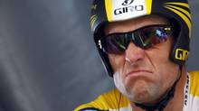 Astana rider Lance Armstrong of the U.S. prepares to start the individual time trial in the first stage of the 96th Tour de France cycling race in Monaco in this July 4, 2009 file photo. (Reuters)