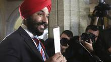 Minister Navdeep Bains holds up a copy of a long-form census during a news conference in Ottawa on Nov. 5, 2015. (CHRIS WATTIE/REUTERS)