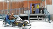 Residents arrive by snowmobile to cast their ballots in the federal election at the arena in Clyde River, Nunavut, on the east coast of Baffin Island, Tuesday, Oct.14, 2008. (Deborah Tobin/Deborah Tobin/The Canadian Press)