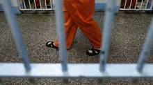 Inmates pace a Toronto jail on Feb. 24, 2011. (Peter Power/Peter Power/The Globe and Mail)