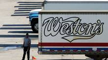 Weston Bakery truck trailers sit at a George Weston Ltd. owned facility on the Queensway in Toronto. (Louie Palu/The Globe and Mail)