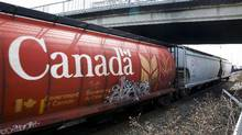 Both Canadian National Railway and Canadian Pacific Railway have seen revenues, profits and carloads slump over the past year amid economic weakness in Canada and the United States. (Jeff McIntosh/The Canadian Press)