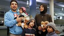 Syrian refugees arrive at the Pearson Toronto International Airport in Mississauga, Ont., on Dec. 18. (MARK BLINCH/REUTERS)