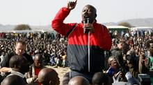 Former youth leader of the African National Congress Julius Malema addresses mine workers at the Lonmin mine near Rustenburg, South Africa, Aug. 18, 2012. (Themba Hadebe/AP)