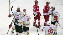 Kunlun Red Star's players celebrate after scoring a goal during a KHL game against Spartak Moscow on Oct. 1, 2016. (Pavel Golovkin/The Associated Press)