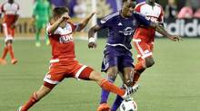 Canadian striker Cyle Larin will likely miss Orlando City SC's match with the Montreal Impact following a DUI arrest. (John Raoux/AP / The Canadian Press)