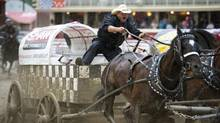 Four-time world champion Jason Glass comes from a long line of chuckwagon driving champions: he`s the son of four-time Stampede champion Tom Glass, the grandson of four-time Stampede champion Ron Glass and great-grandson of three-time Stampede champion Tom Lauder, who competed in the very first chuckwagon races here in 1923. Chuckwagon driver Jason Glass participates in the opening day of competition at the Calgary Stampede in Calgary , Ab. Friday, July 5, 2013. (Kevin Van Paassen/The Globe and Mail)