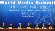 Major Western media companies flocked to attend a conference held in Beijing and hosted by Xinhua. (PETER PARKS)