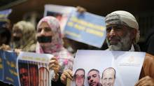 Journalists protest the imprisonment of Al Jazeera journalists Peter Greste, Mohamed Fahmy and Baher Mohamed in Egypt, outside Al Jazeera offices in Sanaa June 25, 2014. (Khaled Abdullah/REUTERS)