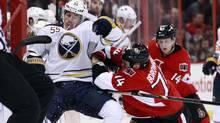 Ottawa Senators' Mark Borowiecki (R) hits Buffalo Sabres' Jochen Hecht during the first period of their NHL hockey game in Ottawa February 5, 2013. (Reuters)