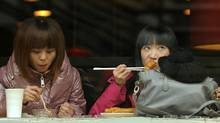 Diners eat in a Beijing restaurant on Tuesday, Feb. 15, 2011. The government said consumer prices were up 4.9 per cent compared to a year ago. (PETER PARKS/PETER PARKS/AFP/GETTY IMAGES)