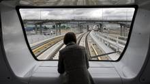 A passenger on the Canada Line in Vancouver, March 27, 2009. (Andy Clark/Reuters/Andy Clark/Reuters)