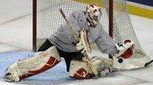 Canadian junior team member Olivier Roy makes a save during practice in Buffalo on Saturday. (DOUG BENZ/REUTERS)