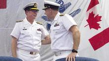 Vice-Admiral Mark Norman, left, then-vice-chief of defence staff, speaks with Vice-Admiral of the Royal Canadian Navy Ron Lloyd during a change of command ceremony last June in Ottawa. (Adrian Wyld/The Canadian Press)