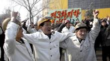 North Korean workers at the Chollima Steel Complex celebrate North Korea's nuclear test February 13, 2013, in this picture released by the North's official KCNA news agency in Pyongyang. North Korea conducted its third nuclear test on Tuesday. (KCNA/REUTERS)