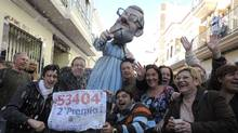 People celebrate after winning the second prize of Spain's Christmas lottery named 'El Gordo' (the Fat One) in Manises, near Valencia, on December 22, 2011. The world's richest lottery showered prizes of up to $3.3-billion on crisis-hit Spaniards. (Jose Jordan/AFP/Getty Images/Jose Jordan/AFP/Getty Images)