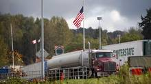 Commercial trucks entering the United States from Canada, such as these in Surrey, B.C., may see their fee go up to $8 (U.S.) from $5.25 for each crossing without a transponder. (Ben Nelms For The Globe and Mail)