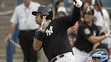 New York Yankees' Alex Rodriguez hits a broken-bat single to right field during the third inning of a spring training baseball game against the Tampa Bay Rays on Thursday. (Steve Nesius/AP)