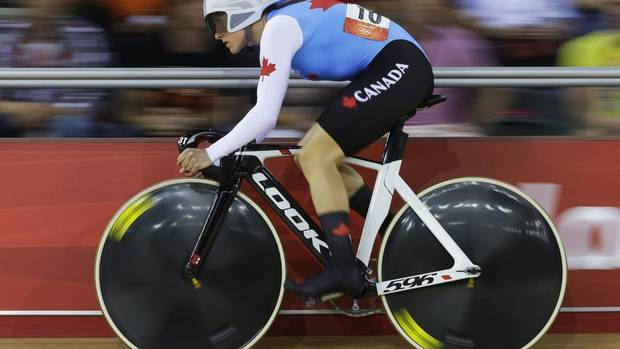 Canada's Tara Whitten competes in the women's omnium flying lap event, during the 2012 Summer Olympics, Monday, Aug. 6, 2012, in London.