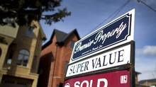 A sold sign in front of a home in downtown Toronto. (Peter Power/The Globe and Mail)