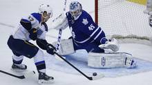 Toronto Maple Leafs Jonathan Bernier makes a save on St. Louis Blues Vladimir Sobotka during the first period of their NHL hockey game in Toronto, Tuesday March 25, 2014 (Mark Blinch For The Globe and Mail)