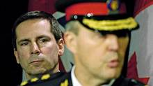 Ontario Premier Dalton McGuinty looks on as Toronto Police Chief Bill Blair speaks during a news conference on January 5, 2006. (Aaron Harris)
