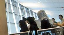 A still from a YouTube video taken at Trudeau airport in Montreal shows veiled women boarding an Air Canada flight for Heathrow.