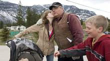 Winston Blackmore, the religious leader of the polygamous community of Bountiful, B.C., receives a kiss from one of his daughters as a son and a grandchild look on April 21, 2008 near Creston, B.C. A judge has postponed his decision on whether video testimony from a B.C. court case on polygamy can be broadcast to the public, saying he wants to hear from one of the witnesses involved. (Jonathan Hayward/The Canadian Press/Jonathan Hayward/The Canadian Press)