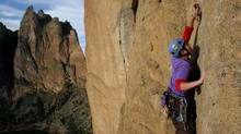 Erik Gerdes, 30, hooks his rope into the bolt above his head at Cinammon Slab wall at Smith Rock State Park near Redmond, Ore., Friday, March 16, 2007. (Deanna Dent)