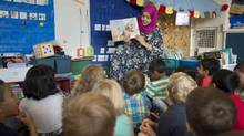 Sabeehah Motala, an early childhood educator reads to a senior kindergarten class at Wilkinson Public School (Fred Lum/The Globe and Mail)
