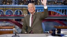David Letterman waves to his audience after announcing that he intends to retire in 2015, in New York, April 3, 2014. (JEFFREY NEIRA/CBS)