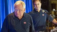 George Gillett, left, pauses to compose himself after announcing the sale of the Montreal Canadiens in September. Geoff Molson, the head of the new ownership group, looks on during a news conference before the team's celebrity golf tournament. (Ryan Remiorz/Ryan Remiorz/CP)