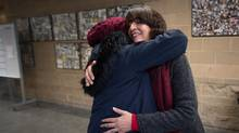 Abeer Al-Kozbary, right, a multicultural worker for the Surrey school district, receives a hug from Grade 12 student Zainab Salam, 17, who moved to Canada from Iraq in 2014 with her mom and two brothers, at Guildford Park Secondary School in Vancouver, B.C., on Thursday December 15, 2016. (DARRYL DYCK/THE GLOBE AND MAIL)