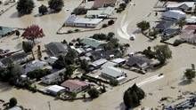 Jet boats drive through the flooded streets of the North Island town of Edgecumbe in New Zealand, on April 6, 2017. (Andrew Warner/AP)