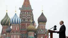 Russian President Vladimir Putin, left, addresses the Victory Day Parade, which commemorates the 1945 defeat of Nazi Germany on the Red Square in Moscow, Russia, Wednesday, May 9, 2012, with the St. Basil Cathedral in the background. (Alexander Zemlianichenko/Alexander Zemlianichenko/AP)