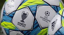 Official soccer balls with the logo of the 2012 Champions League final are seen on the pitch during a practice session. Chelsea takes on Napoli in Wednesday's knockout phase second leg match at Stamford Bridge in London. REUTERS/Michael Dalder (Michael Dalder/Reuters)