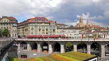 In Lausanne, the funky Flon club and cafe district sits beneath and Grand Pont in Lausanne, while the Gothic catherdral towers over the town. (Cinda Chavich for The Globe and Mail)