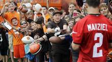 Young fans clamor for autographs from Cleveland Browns quarterback Johnny Manziel (2) after practice at NFL football training camp in Berea, Ohio Tuesday, Aug. 12, 2014. (Mark Duncan/AP)