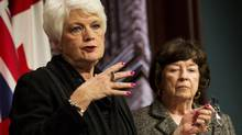 Minister of Education Liz Sandals, left, along with lead investigative reviewer into the trustee and staff at the Toronto District School Board, Margaret Wilson, hold a press conference regarding their recommendations from their report at Queen's Park in Toronto on Thursday, January 15, 2015. THE CANADIAN PRESS/Nathan Denette (Nathan Denette/THE CANADIAN PRESS)