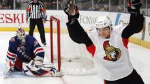 Ottawa Senators' Erik Karlsson, right, celebrates after scoring in a shootout against the New York Rangers, in New York in this March 24, 2011 file photo. (Frank Franklin II/THE CANADIAN PRESS)