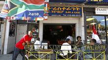 """Restaurant owner Yohannes """"Johnny"""" Zerea stands outside the Rendez-vous on the Danforth, which has a thriving Ethiopian community near the intersection of Greenwood Avenue. (Deborah Baic/The Globe and Mail)"""