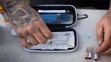 Dan Stadt displays the contents of a Naloxone kit which is used to reverse the effects of an opioid overdose, in Vancouver, B.C., on Thursday November 10, 2016. Canada's provinces and territories plan to set up a national narcotics monitoring network that would provide the first comprehensive snapshot of the number of opioids doctors are prescribing to their patients. (DARRYL DYCK for The Globe and Mail)