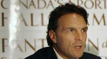 Former NFL and CFL football quarterback Doug Flutie speaks during a news conference for Canada's Sports Hall of Fame inductees in Toronto October 25, 2007. Flutie is the first non-Canadian to be inducted to the Hall of Fame. REUTERS/Mike Cassese (MIKE CASSESE)