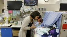 Seema Patel caring for her son Kaelen as part of a new program putting the parents in charge of their premature babies at the neonatal intensive care unit of Mount Sinai Hospital in Toronto, Feb. 11, 2013. (Fernando Morales/The Globe and Mail)