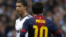 "Barcelona's Lionel Messi looks on as Real Madrid's Cristiano Ronaldo gestures during their Spanish first division ""classic"" match at the Santiago Bernabeu stadium in Madrid, March 2, 2013. (PAUL HANNA/REUTERS)"