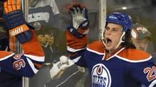 Edmonton Oilers' Ryan Jones (R) celebrates a goal against the Columbus Blue Jackets during the third period of their NHL hockey game in Edmonton December 2, 2011. REUTERS/Dan Riedlhuber (Dan Riedlhuber/Reuters)