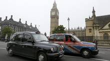 London cabs in Parliament Square, London, Monday, Oct. 22, 2012. The maker of London's world-famous black cabs says it will go into administration after failing to secure an injection of cash from one of its largest shareholders. (Kirsty Wigglesworth/AP)